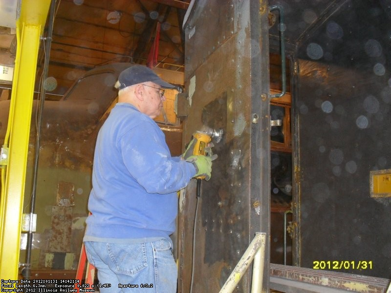 Joe using wirewheel to smooth steel in prep for future priming 1-31-2012