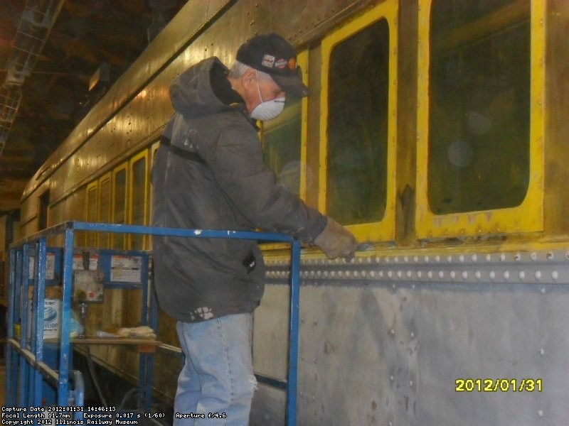 """Bondo"" Bill working more of his magic ie caulking underneath window frames  1-31-12"