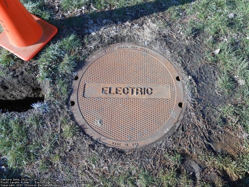 Electric manhole near admission booth.