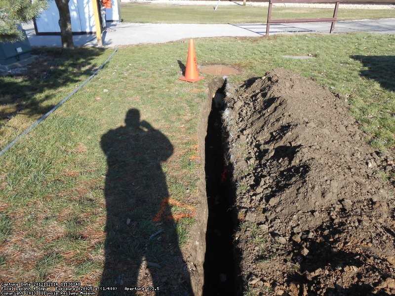 Trench for service conduit.