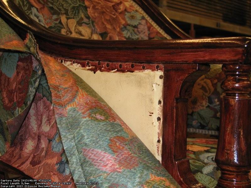 John applied stain to the woodwork and left the original upholstery intact underneath his work.