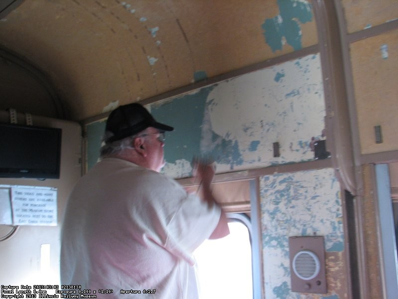 Mike peeling paint from the walls in Pacific Peak March 3, 2013.
