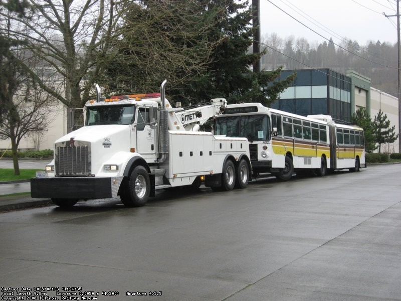 The coach being towed to the rail yard.  (03/03/2008)