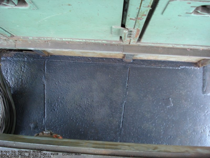 The sub floor under the cab was needle chipped out and rust converter applied
