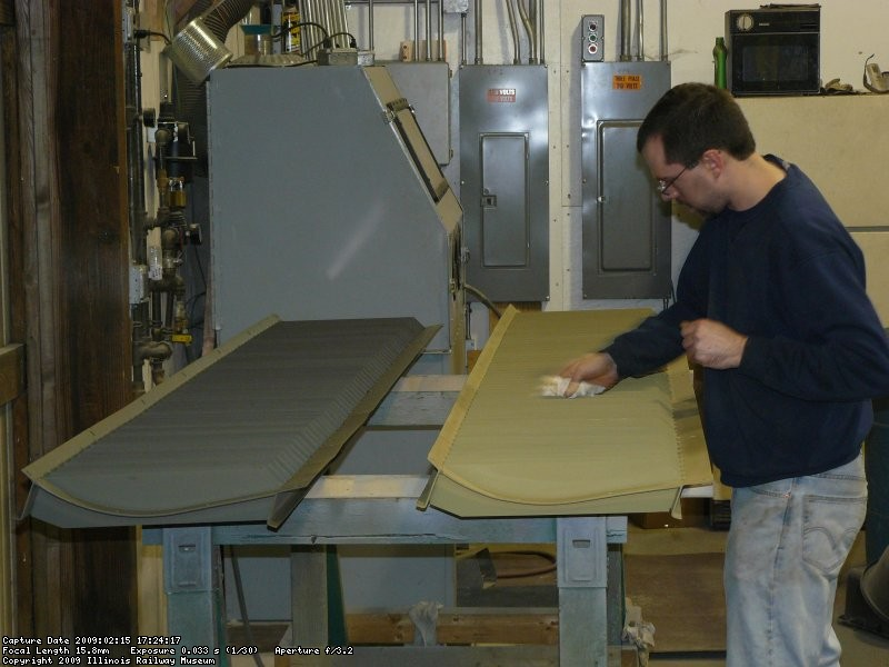 Kyle wiping the DB louvers to get them ready for paint.
