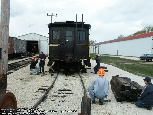05.01.05 -  THE CAR IS BEING JACKED UP BY THE TRACK DEPARTMENT MEMBERS TO CHANGE A DAMAGED PAIR OF WHEELS.