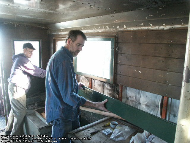 02.13.05 - VICTOR HUMPHREYS AND BUZZ MORISETTE INSTALL NEW INTERIOR SIDING WHICH BUZZ HAD MILLED FROM RAW WOOD.