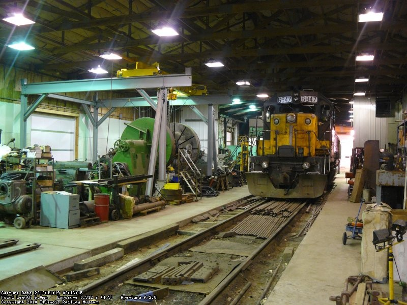 CNW 6847 in the steam shop next to the large wheel lathe and over head crane.