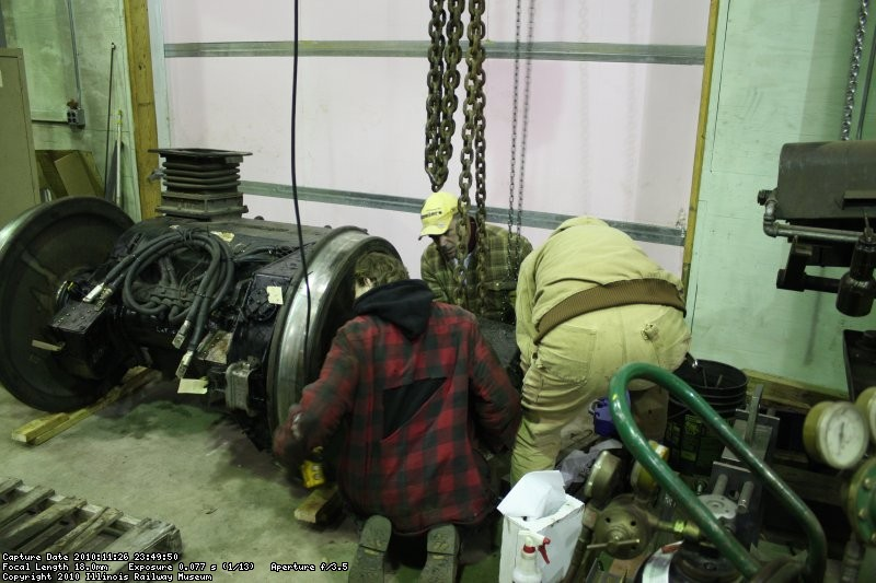 Jamie, Dan and Roger mounting the roller bearings on the end of the axle.