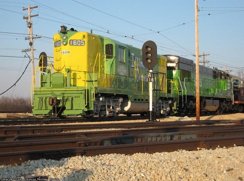 IT 1605 on the head end of a string of diesels