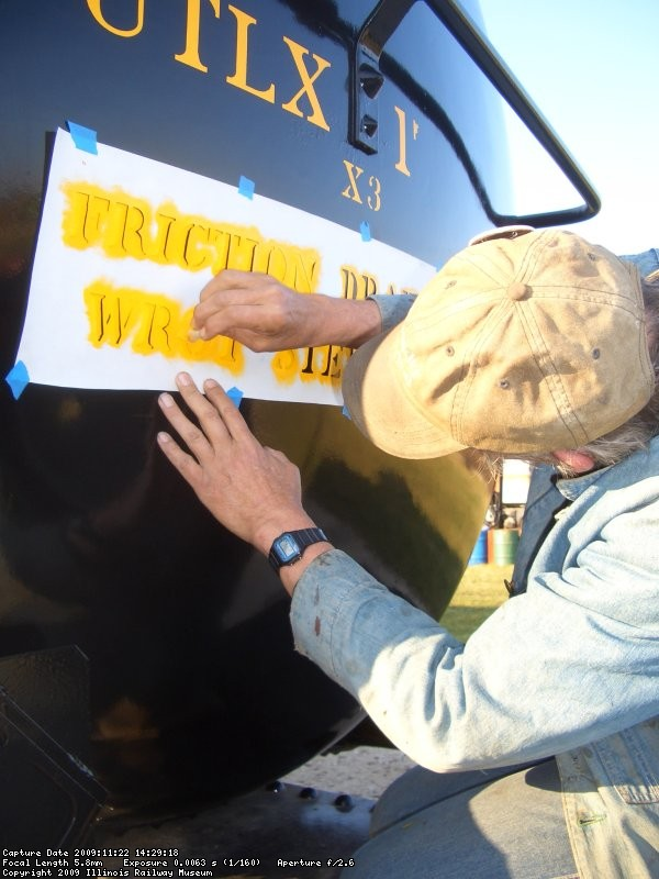 11.22.09 - BOB STARTS TO STENCIL THE LETTERS.  TWO COATS ARE REQUIRED TO COVER THE BLACK.