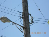 service drop to Schroder store. connections at pole.  Note white insulator on neutral.  Brown insulators on phase wires.