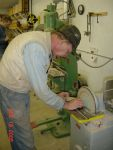 12.18.05 - BOB KUTELLA IS SANDING ONE OF THE RETAINING ARC SEGMENTS SO THAT IT FITS INSIDE OF THE STEEL RIM.