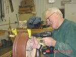12.21.05 - DICK CUBBAGE IS DRILLING HOLES FOR THE BOLTS THAT SECURE THE SPOKES AND ARC SEGMENT TO THE HUB.