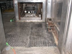Corrugated steel reapplied over the repaired floor.