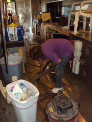 Shelly Vanderschaegen vacuuming the galley floor 7/14/13