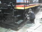 Jamie painting trucks and tanks on CBQ 9255