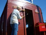 09.02.07 - KIRK WARNER APPLIES THE TRIM TO THE A DOOR OF THE CABOOSE.