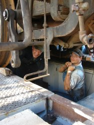 Steam department volunteer Collin crawled in between the frame of the locomotive to watch for potential problems during the drop