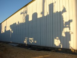 The locomotive casts a shadow on barn 9 as prep for the drop is completed in the late summer light