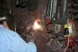 Dennis welds a socket into place