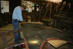 Rick prepares sheet metal for fitting