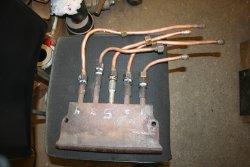 Repaired stoker manifold