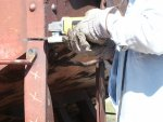 NEIL SCHWINBECK IS CUTTING THE DAMAGED VERTICAL HANDOLD SUPPORT.