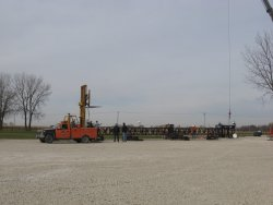 The forklift gets into position to keep the bottom from dragging as the top is lifted.