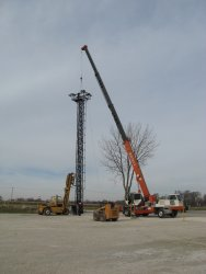 Working together, the crane and forklift get the job done.