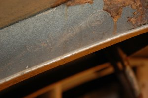 'USS' standing for US Steel Corp was found stamped on one of the roof support braces in the steam gen room. - DSC_8497.JPG