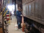 Welder Terry Borden does grinding on the last two patches needed to be welded onto 749.
