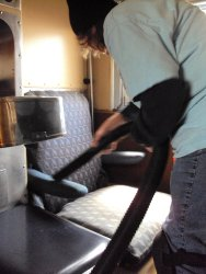 Shelly vacuuming a roomette in the Loch Sloy - Photo by Pauline Trabert