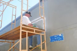 Kevin Kriebs continues adhesive removal on the 1st Exhibit Car - Photo by Shelly Vanderschaegen