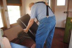 John McKKelvey installing a reupholstered DM&IR 84 smoking section seat bottom - Photo by Shelly Vanderschaegen