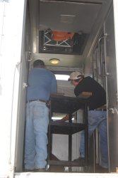 Michael Baksic and Andy Townsend work to position the AC unit  - Photo by Shelly Vanderschaegen