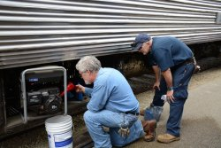 Michael Baksic and Ray Mormann work on a generator - Photo by Jon Habegger