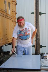 Chuck Trabert painting a refurbished Dynamometer door - Photo by Shelly Vanderschaegen