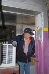 Ray Mormann helping to remove air conditioners - Photo by Shelly Vanderschaegen