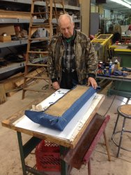 John McKelvey pinned new material to a previously stripped Santa Fe Lounge Car seat - Photo by Michael McCraren