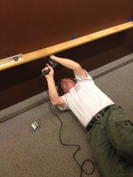 Mark Gellman installing a shelf - Photo by Michael McCraren