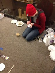 Patrice brought paper plates and cups to make a mock up of the china exhibit - Photo by Michael McCraren