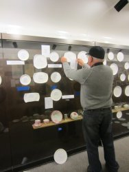 Jim Windmeier arranging the paper plate china - Photo by Patrice Connelly