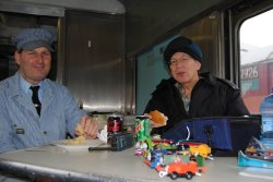 Happy Holidays Railway crew members Jerry Saunders and Jim West joined in the fun - Photo by Shelly Vanderschaegen
