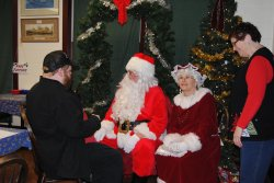 David visits with Santa and Mrs. Claus as Susan Stepek looks on - Photo by Shelly Vanderschaegen