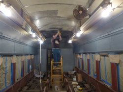 Brian LaKemper wire-wheeling a ceiling panel that was needle-chipped late last fall - Photo courtesy of Brian LaKemper