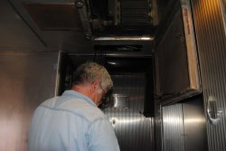 Michael Baksic working on a wiring project inside the Birmingham - Photo by Shelly Vanderschaegen