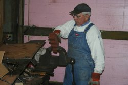 Ed works on the sander manifold