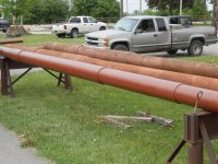 Steel strain poles from Dayton being cleaned and primed.