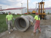 Concrete sawing contractor cutting pipe to size.